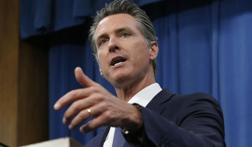 In this July 23, 2019, file photo, Gov. Gavin Newsom talks to reporters at his Capitol office, in Sacramento, Calif. (AP Photo/Rich Pedroncelli, File)  **FILE**
