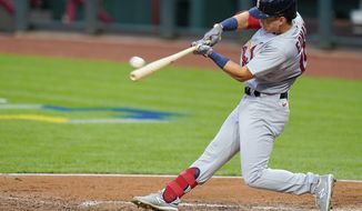 St. Louis Cardinals Tommy Edman hits an RBI double during the third inning of the team's baseball game against the Cincinnati Reds in Cincinnati, Tuesday, Sept. 1, 2020. (AP Photo/Bryan Woolston)