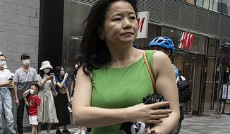Cheng Lei, a Chinese-born Australian journalist for CGTN, the English-language channel of China Central Television, attends a public event in Beijing on Wednesday, Aug. 12, 2020. Cheng has been detained in China, Australia's government said Monday, Aug. 31. Australian officials had a consular visit via video link with Cheng at a detention facility last Thursday, Foreign Minister Marise Payne said in a statement. They will continue to provide assistance and support to her and her family, Payne said.(AP Photo/Ng Han Guan)