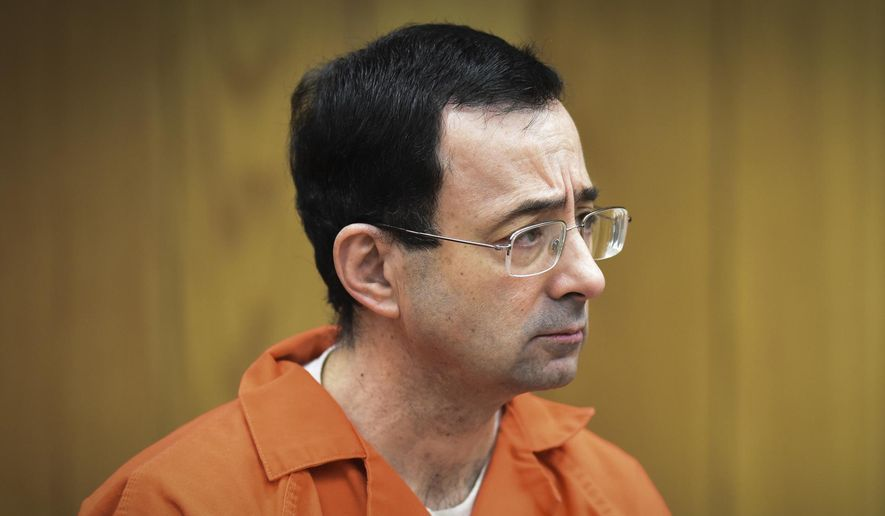 In this Feb. 5, 2018, file photo, Larry Nassar, former sports doctor who admitted molesting some of the nation's top gymnasts, appears in Eaton County Court in Charlotte, Mich. (Matthew Dae Smith/Lansing State Journal via AP, File)