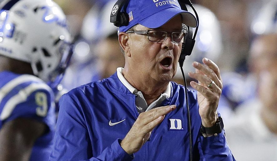 FILE - In this Saturday, Sept. 29, 2018, file photo, Duke head coach David Cutcliffe reacts during the second half of an NCAA college football game against Virginia Tech in Durham, N.C. Cutcliffe is taking over playcalling duties in hopes of helping the Blue Devils find an offensive spark in 2020 after struggling to some of their lowest totals under Cutcliffe the previous season. (AP Photo/Gerry Broome, File)