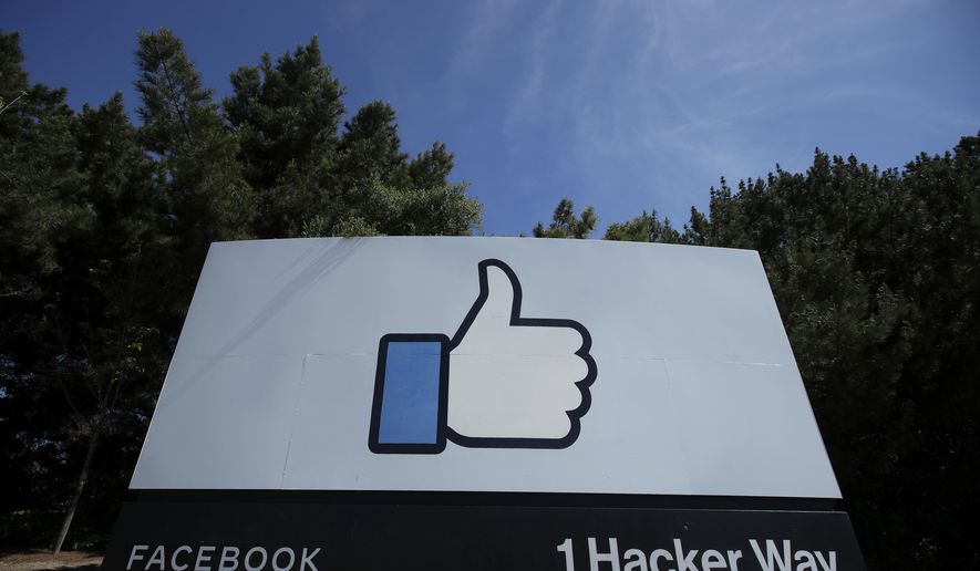 In this April 14, 2020, photo, the thumbs-up Like logo is shown on a sign at Facebook headquarters in Menlo Park, Calif. (AP Photo/Jeff Chiu) **FILE**