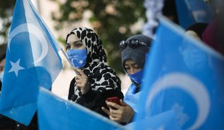 """A tweet posted this month defended China's treatment of Uighur Muslims and disputed allegations that Uighur women in Xinjiang are """"baby-making machines."""" (Associated Press/File)"""