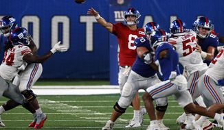 New York Giants quarterback Daniel Jones (8) passes during a scrimmage at the NFL football team's training camp in East Rutherford, N.J., Friday, Aug. 28, 2020. (AP Photo/Adam Hunger)