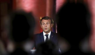 French President Emmanuel Macron attends a media conference in Beirut, Lebanon, Tuesday, Sept. 1, 2020. French President Emmanuel Macron issued a stern warning to Lebanon's political class, urging them to commit to serious reforms within few months or risk punitive action including sanctions, if they fail to deliver. (Gonzalo Fuentes/Pool via AP)