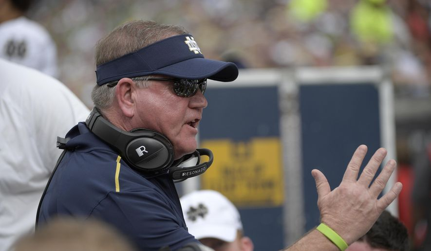 Notre Dame head coach Brian Kelly talks to players at the bench during the Camping World Bowl NCAA college football game against Iowa State Saturday, Dec. 28, 2019, in Orlando, Fla. The 58-year-old Kelly begins his 11th season at Notre Dame when the 10th-ranked Fighting Irish, taking a one-year sabbatical from football independence to join the Atlantic Coast Conference race, open against league rival Duke Sept. 12 at Notre Dame Stadium.  (AP Photo/Phelan M. Ebenhack, File)  **FILE**