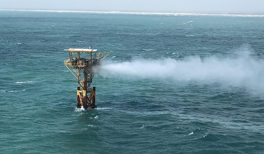 In this image released by the U.S. Coast Guard, natural gas is release from an oil platform approximately three miles offshore of Corpus Christi, Texas, Tuesday, Sept. 1, 2020. Officials responded Tuesday to a release from a well platform off the shore of Texas and the Coast Guard has a pollution response team on the beach to monitor the situation. There were no immediate reports of injuries. (U.S. Coast Guard via AP)