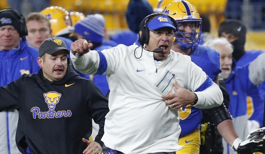 FILE - In this file photo from Nov. 14, 2019, Pittsburgh head coach Pat Narduzzi, center, celebrates a 34-27 overtime win against North Carolina in an NCAA college football game in Pittsburgh. Narduzzi enters his sixth season at Pittsburgh with a potentially dominant defense, and little respect. The Panthers didn't receive a single vote in the preseason AP Top 25, a sign his program still has something to prove in 2020. (AP Photo/Keith Srakocic, File)