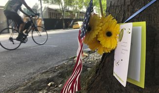 A small memorial to Portland, Oregon fatal shooting victim Aaron J. Danielson, 39, of Portland is shown on Monday, Aug. 31, 2020, at the site where he was killed on Saturday, Aug. 29, 2020, as supporters of President Donald Trump and Black Lives Matter protesters clashed. Danielson was a supporter of the right-wing Patriot Prayer group but few details have emerged about what led up to the shooting. No suspects have been arrested. (AP Photo/Gillian Flaccus)