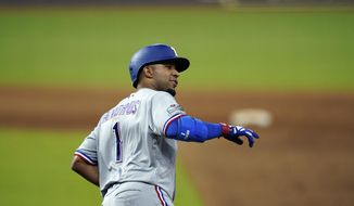 Texas Rangers' Elvis Andrus runs the bases after hitting a home run against the Houston Astros during the ninth inning of a baseball game Tuesday, Sept. 1, 2020, in Houston. (AP Photo/David J. Phillip)