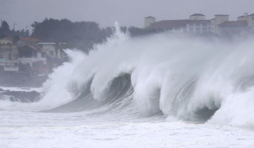 High waves crash a shore as Typhoon Maysak approach on Jeju Island, South Korea, Wednesday, Sept. 2, 2020. An offshore typhoon brought torrents of rain to southern Japan on Wednesday heading to the Korean Peninsula. (Park Ji-ho/Yonhap via AP)