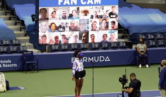 Naomi Osaka, of Japan, wears a mask in honor of Breonna Taylor as she speaks in front of a video display of fans before facing Misaki Doi, of Japan, during the first round of the US Open tennis championships, Monday, Aug. 31, 2020, in New York. (AP Photo/Frank Franklin II)