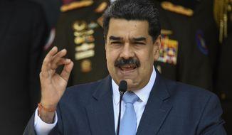 In this March 12, 2020, photo, Venezuelan President Nicolas Maduro speaks at the Miraflores presidential palace in Caracas, Venezuela. (AP Photo/Matias Delacroix) **FILE**