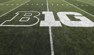 In this Aug. 31, 2019, file photo, the Big Ten logo is displayed on the field before an NCAA college football game between Iowa and Miami of Ohio in Iowa City, Iowa. Big Ten presidents voted 11-3 to postpone the football season until spring, bringing some clarity to a key question raised in a lawsuit brought by a group of Nebraska football players. The vote breakdown was revealed Monday, Aug. 31, 2020, in the Big Ten's court filing in response to the lawsuit. (AP Photo/Charlie Neibergall, File)  **FILE**