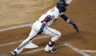 Minnesota Twins' Marwin Gonzalez races to first base as he drives in two runs on a fielder's choice off Chicago White Sox pitcher Lucas Giolito in the second inning of a baseball game Monday, Aug. 31, 2020, in Minneapolis. (AP Photo/Jim Mone)