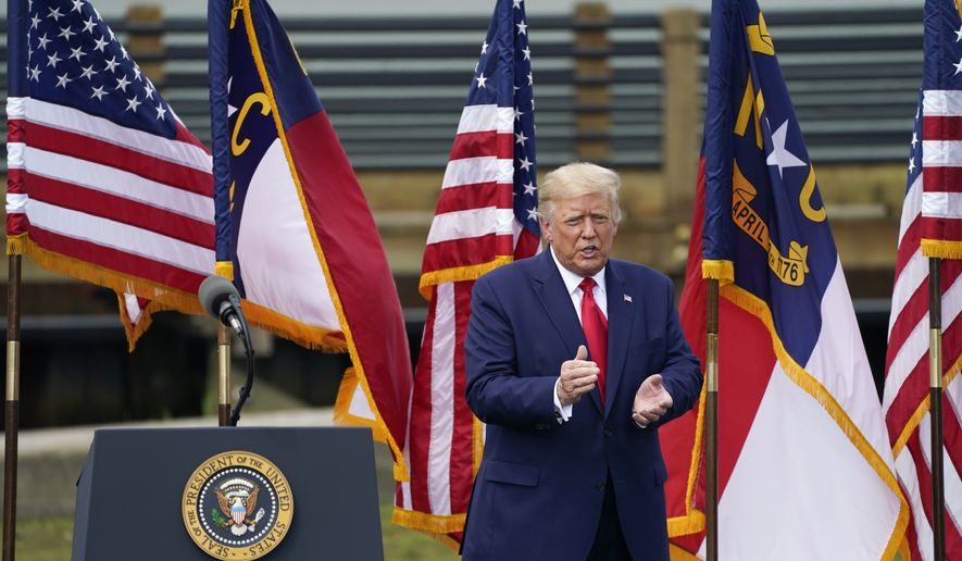 President Donald Trump leaves the stage after a speech on Wednesday, Sept. 2, 2020, in Wilmington, N.C. (AP Photo/Gerry Broome)