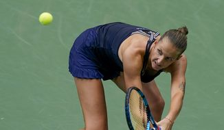 Karolina Pliskova, of the Czech Republic, returns a shot to Caroline Garcia, of France, during the second round of the US Open tennis championships, Wednesday, Sept. 2, 2020, in New York. (AP Photo/Seth Wenig)