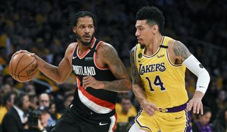 FILE - In this Friday, Jan. 31, 2020 file photo, Portland Trail Blazers forward Trevor Ariza, left, handles the ball while pressured by Los Angeles Lakers guard Danny Green during the first half of an NBA basketball game in Los Angeles. A Los Angeles judge has issued a temporary restraining order keeping the Portland Trail Blazers' Trevor Ariza away from his 12-year-old son after the boy's mother alleged that Ariza had physically abused him, Wednesday, Sept. 2, 2020.  (AP Photo/Kelvin Kuo, File)