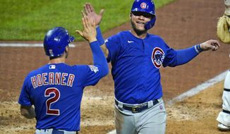 Chicago Cubs' Willson Contreras, right, and Nico Hoerner celebrate after both scored on a single by Anthony Rizzo off Pittsburgh Pirates relief pitcher Derek Holland during the seventh inning of a baseball game in Pittsburgh, Wednesday, Sept. 2, 2020. The Cubs won 8-2. (AP Photo/Gene J. Puskar)