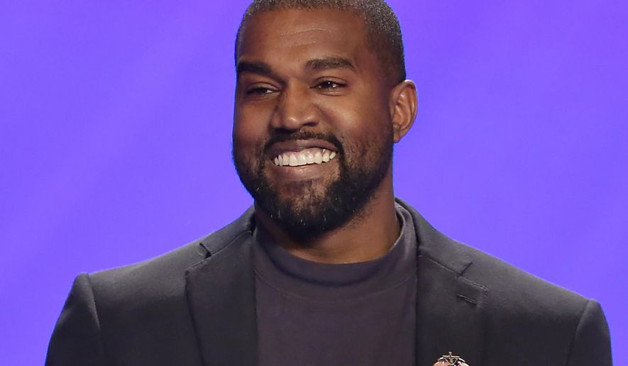 """FILE - This Nov. 17, 2019, file photo shows Kanye West on stage during a service at Lakewood Church in Houston. A law firm with ties to prominent Democrats has filed a lawsuit attempting to keep West off presidential ballots in Virginia. Attorneys for Perkins Coie filed a lawsuit in Richmond on Tuesday, Sept. 1, 2020, on behalf of two people who say they were tricked into signing an """"Elector Oath"""" backing West's candidacy. (AP Photo/Michael Wyke, File)"""