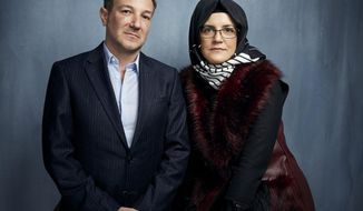 """FILE - Director Bryan Fogel, left, and Hatice Cengiz, fiancee of the murdered journalist Jamal Khashoggi, pose for a portrait to promote the film """"The Dissident"""" during the Sundance Film Festival in Park City, Utah on Jan. 24, 2020.  Briarcliff Entertainment said Wednesday that it has acquired """"The Dissident"""" and will release it theatrically and via on-demand in late 2020 to coincide with the second anniversary of Khashoggi's death. (Photo by Taylor Jewell/Invision/AP, File)"""