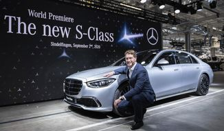 """Ola Kaellenius, Chairman of the Board of Management of Daimler AG, presents the new Mercedes-Benz S-Class at the world premiere in the """"Factory 56"""" in Sindelfingen, Germany, Wednesday, Spt.2, 2020. (Silas Stein/dpa via AP)"""