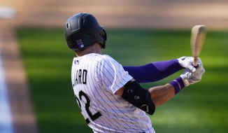 Colorado Rockies' Sam Hilliard connects for a three-run home run off San Francisco Giants relief pitcher Tyler Rogers in the seventh inning of a baseball game Wednesday, Sept. 2, 2020, in Denver. (AP Photo/David Zalubowski)