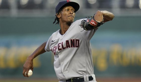Cleveland Indians starting pitcher Triston McKenzie winds up during the first inning of the team's baseball game  against the Kansas City Royals at Kauffman Stadium in Kansas City, Mo., Wednesday, Sept. 2, 2020. (AP Photo/Orlin Wagner)