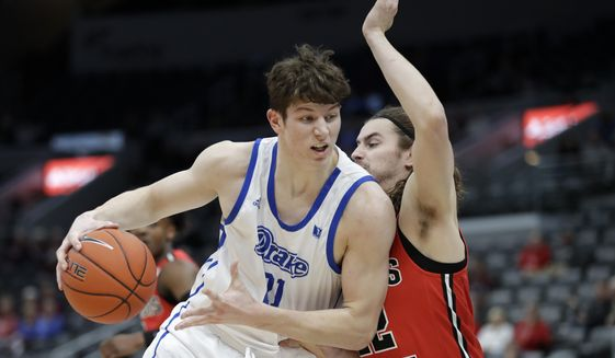 In this Thursday, March 5, 2020 file photo,Drake's Liam Robbins, left, heads to the basket as Illinois State's Matt Chastain defends during the first half of an NCAA college basketball game in the first round of the Missouri Valley Conference men's tournament in St. Louis. .(AP Photo/Jeff Roberson, File)  **FILE**