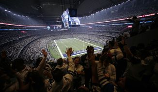 The Dallas Cowboys play the Seattle Seahawks during the first half of an NFC wild-card NFL football game in Arlington, Texas, Saturday, Jan. 5, 2019. The owner of the Cowboys hopes the 80,000-seat venue with standing room space that pushes capacity past 90,000 will be filled closer to capacity as the pandemic-altered NFL season goes on. (AP Photo/Roger Steinman, File)  **FiLE**