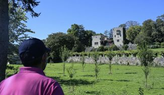 A man looks at the Pazo de Meiras palace in the Galician region of Sada on Wednesday Sept. 2, 2020. A Spanish court has ordered the heirs of Gen. Francisco Franco to hand over to the state the ownership of a 19th-century palace used by the late dictator as a summer retreat.The Spanish government had filed a lawsuit against the dictator's descendants arguing that the Pazo de Meiras palace in the northwestern Galicia region was illegally acquired by the former dictator during the country's 1936-1939 Civil War. (M.Dylan/Europa Press via AP)