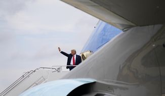 President Donald Trump waves as he boards Air Force One for a trip to Wilmington, N.C., Wednesday, Sept. 2, 2020, in Andrews Air Force Base, Md. (AP Photo/Evan Vucci)