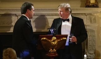 FILE - In this Feb. 24, 2019, file photo, President Donald Trump greets Montana Gov. Steve Bullock, left, at the podium where Bullock will give a toast at the Governors' Ball in the State Dining Room of the White House in Washington. Trump's reelection campaign and the Republican Party sued Montana on Wednesday, Sept. 2, 2020, over Democratic Gov. Bullock's plan giving counties the choice to use all mail ballots this November. (AP Photo/Carolyn Kaster, File)