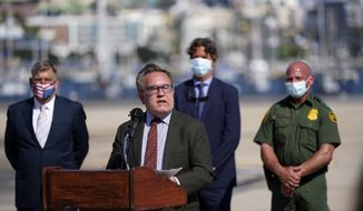 Andrew Wheeler, administrator for the Environmental Protection Agency, front, speaks during a news conference Wednesday, Sept. 2, 2020, in San Diego. The U.S. government announced work has begun to stop a decades-old problem of millions of gallons of sewage from Tijuana, Mexico, flowing into the United States and polluting the waves where Southern California meets the border. (AP Photo/Gregory Bull)