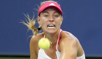 Angelique Kerber, of Germany, returns a shot to Anna-Lena Friedsam, of Germany, during the second round of the US Open tennis championships, Wednesday, Sept. 2, 2020, in New York. (AP Photo/Seth Wenig)