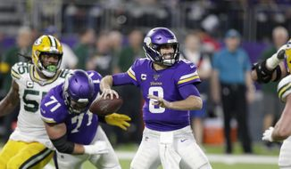 In this Monday, Dec. 23, 2019, file photo, Minnesota Vikings quarterback Kirk Cousins throws a pass during the second half of an NFL football game against the Green Bay Packers in Minneapolis. (AP Photo/Andy Clayton-King, File)