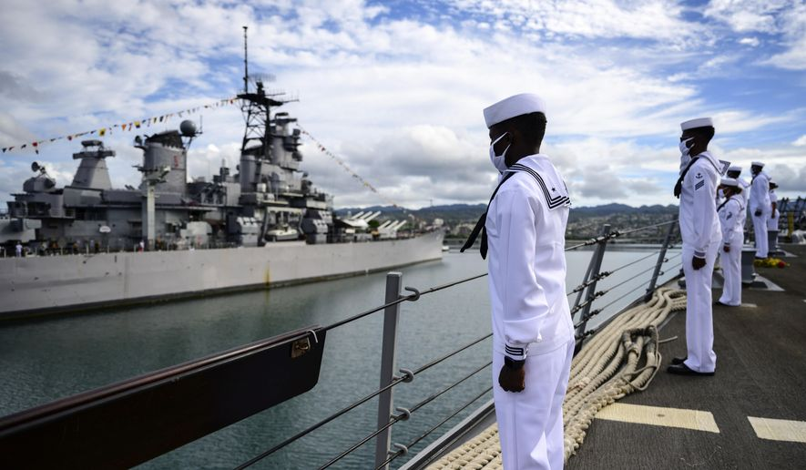 In this image provided by the U.S. Navy, sailors aboard the guided-missile destroyer USS Michael Murphy (DDG 112) render honors to Battleship Missouri Memorial during the official ceremony for the 75th anniversary of the Japanese surrender that ended World War II, Wednesday, Sept. 2, 2020, in Honolulu, Hawaii. (Petty Officer 1st Class Devin Langer/U.S. Navy via AP)