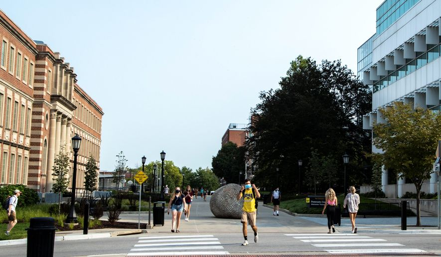 More than 1,100 students at the University of Iowa have self-reported testing positive for COVID-19, and tests were not mandatory upon return to campus last month. The state is currently a hot spot for infections. (ASSOCIATED PRESS)