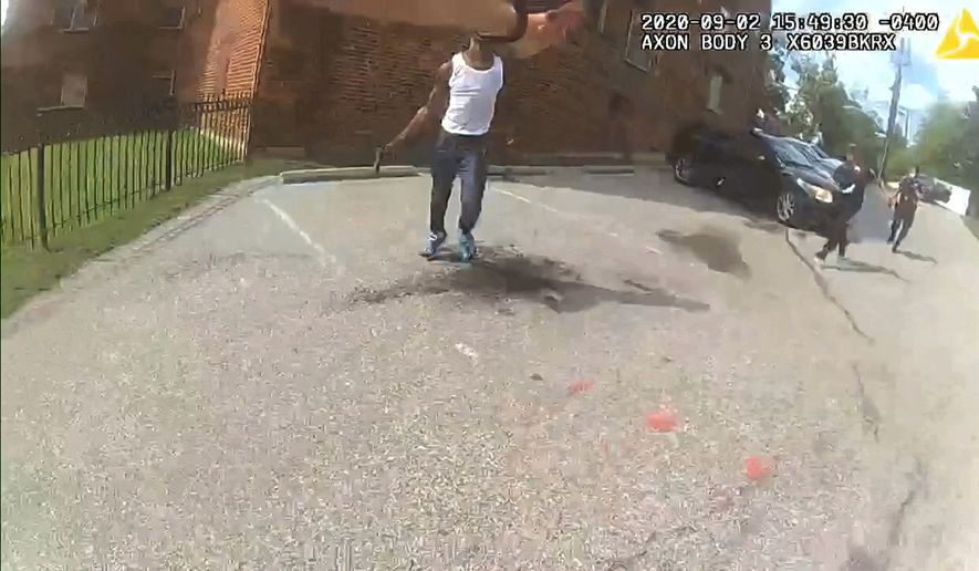 This image from video released by the Metropolitan Police Department, shows body cam video during a foot pursuit with Deon Kay, center, in Washington, on Wednesday afternoon, Sept. 2, 2020. Police in the nation's capital released body camera footage from the officer who fatally shot the Black 18-year-old in the chest. (Metropolitan Police Department via AP) ** FILE **