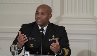 "U.S. Surgeon General Jerome Adams speaks during a roundtable discussion about ""Recovery at Work: Celebrating Connections,"" in the East Room of the White House, Thursday, Sept. 3, 2020, in Washington. (AP Photo/Alex Brandon) ** FILE **"