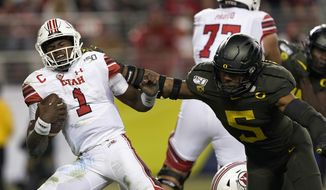 In this Dec. 6, 2018, file photo, Utah quarterback Tyler Huntley (1) is sacked by Oregon defensive end Kayvon Thibodeaux (5) during the second half of an NCAA college football game for the Pac-12 Conference championship in Santa Clara, Calif. Thibodeaux was selected to The Associated Press preseason All-America first-team, Tuesday, Aug. 25, 2020. (AP Photo/Tony Avelar)  **FILE**