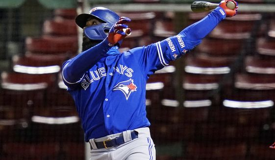 Toronto Blue Jays' Teoscar Hernandez watches his three-run home run that broke a 2-2 tie during the 10th inning of the team's baseball game against the Boston Red Sox, Thursday Sept. 3, 2020, in Boston. (AP Photo/Charles Krupa)
