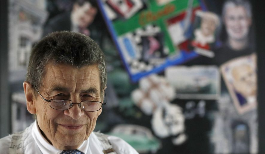 Human rights lawyer Geoffrey Nice stands in front of a picture collage that a friend has done of him at his home in Adisham, England, Wednesday, Sept. 2, 2020. The prominent British human rights lawyer is convening an independent tribunal in London with public hearings next year, to look into the Chinese government's alleged rights abuses against the Uighur Muslim minority in the far western province of Xinjiang.(AP Photo/Frank Augstein)
