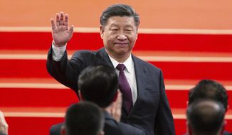 FILE - In this Dec. 20, 2019, file photo, Chinese President Xi Jinping waves during the inauguration ceremony in Macao to mark the 20th anniversary of the former Portuguese colony's handover to Chinese rule. China, Thursday, Sept. 3, 2020, is commemorating the 75th anniversary of the end of World War II in the Pacific, during which it endured a brutal invasion and occupation of much of its territory by Japan. (AP Photo, File)