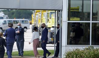 In this image taken from a motorcade, Democratic presidential candidate former Vice President Joe Biden exits a building after meeting with relatives of Jacob Blake at General Mitchell International Airport on Thursday, Sept. 3, 2020, in Milwaukee. (AP Photo/Carolyn Kaster)