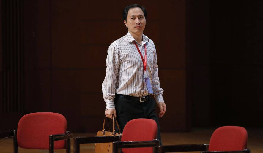 """In this Wednesday, Nov. 28, 2018. file photo, genetic researcher He Jiankui arrives for the Human Genome Editing Conference in Hong Kong. A new report from an international commission of scientists sets criteria for when altering genes in human embryos might be considered, two years after He shocked the world by claiming to have made the first """"CRISPR babies."""" (AP Photo/Kin Cheung)"""