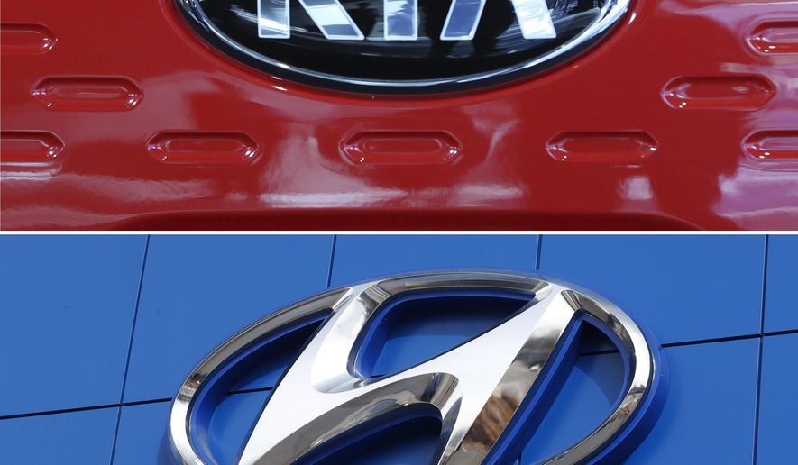 FILE- This combination of file photos shows the logo of Kia Motors during an unveiling ceremony on Dec. 13, 2017, in Seoul, South Korea, top, and a Hyundai logo on the side of a showroom on April 15, 2018, in the south Denver suburb of Littleton, Colo., bottom. The Korean automakers are recalling over 591,000 vehicles in the U.S. to fix a brake fluid leak that could cause engine fires.  (AP Photo, File)