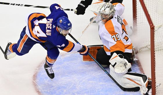 Philadelphia Flyers goaltender Carter Hart (79) stops New York Islanders center Jean-Gabriel Pageau (44) during overtime period NHL Stanley Cup Eastern Conference playoff hockey game action in Toronto, Thursday, Sept. 3, 2020. (Frank Gunn/The Canadian Press via AP)