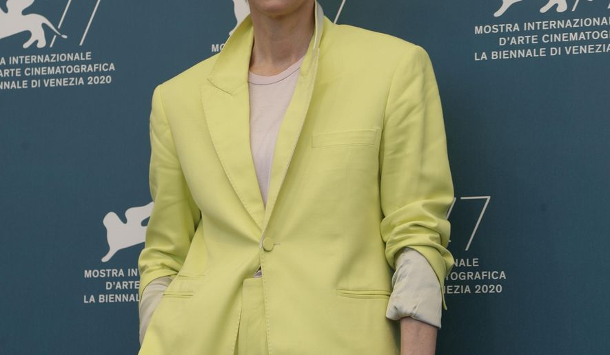 Actress Tilda Swinton poses during the photo call for the movie 'The human voice' during the 77th edition of the Venice Film Festival at the Venice Lido, Italy, Thursday, Sep. 3, 2020. The Venice Film Festival goes from Sept. 2 through Sept. 12. Italy was among the countries hardest hit by the coronavirus pandemic, and the festival will serve as a celebration of its re-opening and a sign that the film world, largely on pause since March, is coming back as well. (AP Photo/Domenico Stinellis)