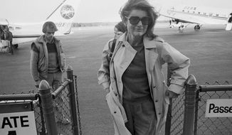 FILE — In this Nov. 21, 1983 file photo Jacqueline Kennedy Onassis arrives at the Barnstable Airport, in Hyannis, Mass., to observe the 20th anniversary of the assassination of President John F. Kennedy. The Martha's Vineyard estate of the former first lady is being sold to a pair of nonprofits that plan on turning the property into conservation land open to the public, officials said Thursday, Sept. 3, 2020. (AP Photo/Paul Benoit, File)